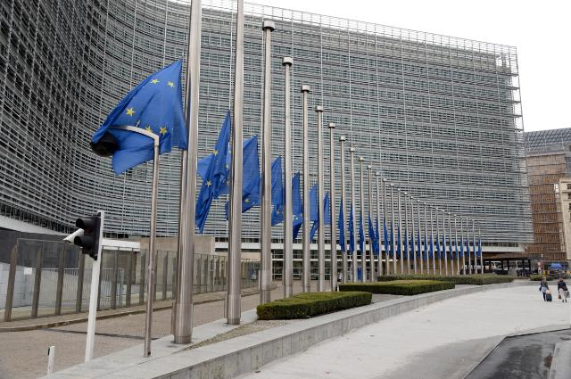European flags fly at half-mast to pay tribute to the victims of the terrorist attacks in France