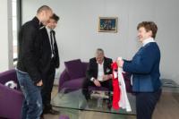 Dimitar Berbatov, on the left, Kristalina Georgieva, on the right, holding a football shirt, and Daniel Giorev, Member of the cabinet of Kristalina Georgieva, 2nd from the left