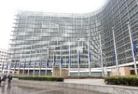European flags at half-mast in front of the Berlaymont building