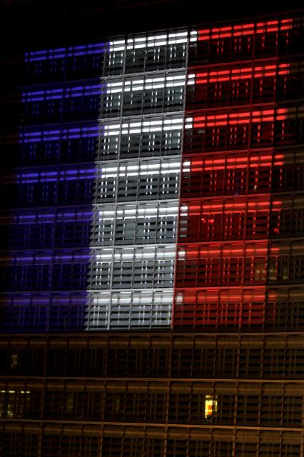 Berlaymont building illuminated with the colours of the French flag to pay tribute to the victims of the terrorist attacks in France