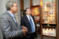 Orhan Pamuk, on the left, and José Manuel Barroso, both looking at framed photographs