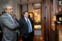 Orhan Pamuk, on the left, and José Manuel Barroso, on the right, both looking at framed photographs