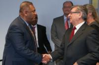 Handshake between Mangala Samaraweera, on the left, and Karmenu Vella