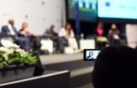 The speech by Federica Mogherini, seen through the screen of a smartphone