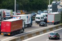 Busses, commercial vehicles, vans and lorries driving on a motorway