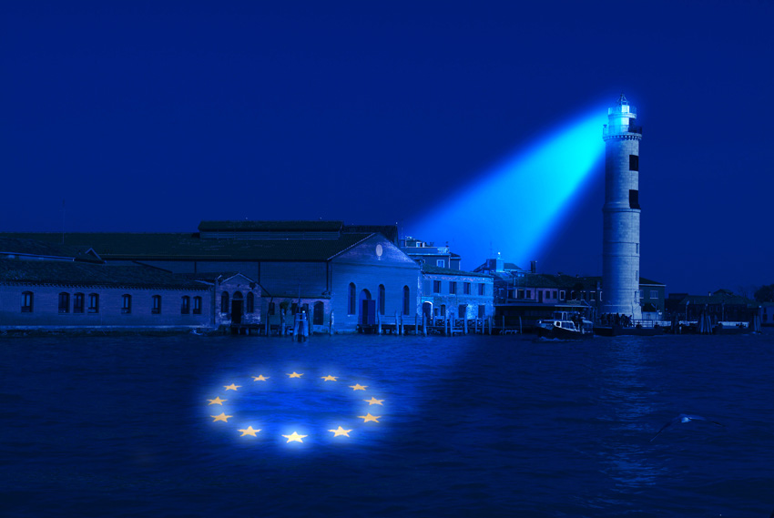 Lighthouse projecting the EU symbol onto water