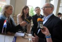 Janusz Lewandowski, on the right, answering the...