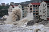 Huge wave hiting the dike as Typhoon Fitow moves to make its landfall in Wenling, east China's Zhejiang province