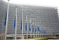 European flags fly at half-mast to pay tribute to the victims of the attacks in Germany