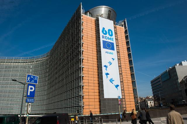 Banner with the logo of the 60th anniversary of the Treaties of Rome on the Berlaymont building