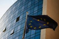 The EU flag waving in front the building with offices of the European Investment Bank and the Delegation of the EU to Belgrade