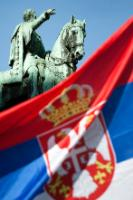 The statue of Prince Mihailo Obrenovic with the Serbian national flag in the foreground