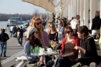 People in a cafe on the banks of the Sava river