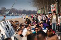 People walking on the banks of the Ada Ciganlija lake