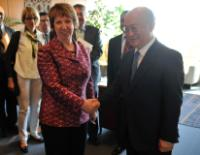 Handshake between Yukiya Amano and Catherine Ashton (in the foreground, from right to left)