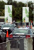 The vehicles of the Mexican Federal Police on guard duty in front of the Cancun Messe Convention Center