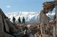 Rrescuers standing on rubble after the earthquake in the village of Onna, near the Abruzzo capital L'Aquila