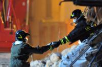 Firemen looking for survivors in the rubble of a four-storey building  in the Abruzzo capital L'Aquila, epicentre of a violent earthquake