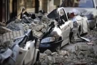 View of cars crashed by debris in Lorca, southern Spain, after a magnitude 5.1 quake killed at least 8 people