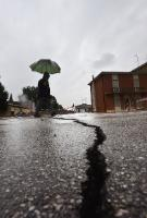 A man crossing a damaged street in San Carlo after the earthquake the day before in north Italy