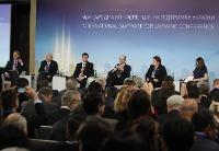 Chris Alexander, Canadian Minister for Citizenship and Immigration, William Danvers, Deputy Secretary-General of the Organisation for Economic Co-operation and Development (OECD), Valdis Dombrovskis, Arseniy Yatsenyuk, holding a microphone, Laimdota Straujuma and Myroslava Gongadze, Ukrainian journalist; moderator of the General Session of the International Support for Ukraine Conference (from left to right)