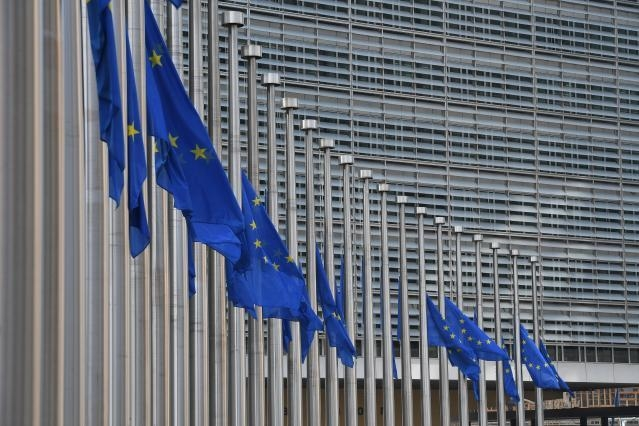 European flags fly at half-mast in front of the Berlaymont Building to pay tribute to the victims of the terrorist attack in Liège, Belgium