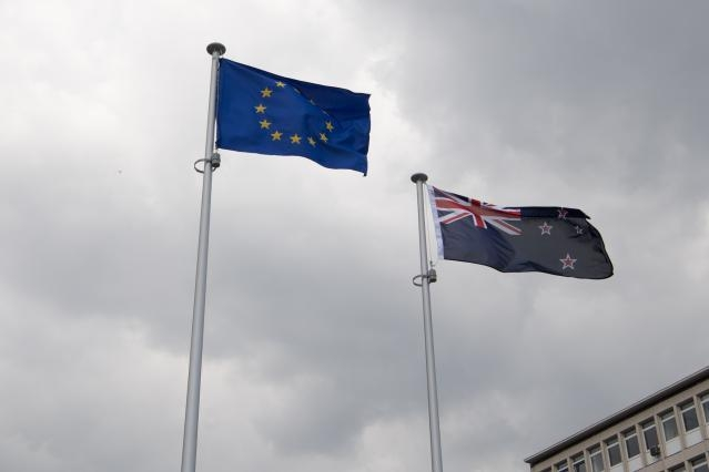 Australian, New Zealand and European flags in front of Berlaymont Building, Headquarter of the EC