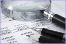 Magnifying glass on a business report © thinkstockphotos.co.uk