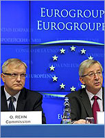 Mr Olli RHEN, Member of the European Commission (left), Mr Jean-Claude JUNCKER, Prime Minister of Luxembourg, President of the Eurogroup © The Council of the European Union