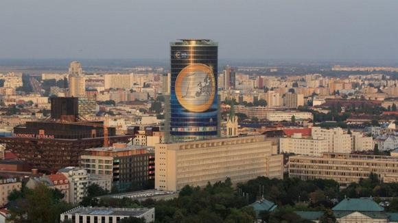 A vast euro coin on the front of the NBS building in Bratislava