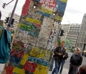 A street scene showing part of the Berlin wall