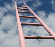 An abstract of a pink ladder rising into the sky