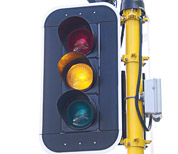 A set of traffic lights at amber