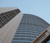 View looking upwards at a modern skyscraper