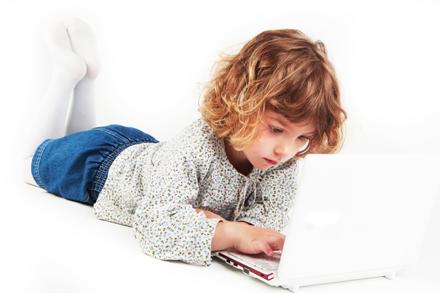 Girl using laptop (c) istock