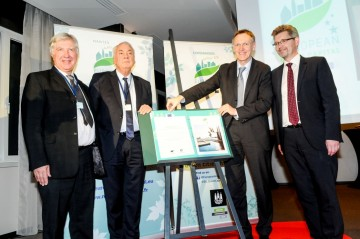 """Pictured at the handover ceremony is the European Commissioner for the Environment, Janez Potočnik, turning the page of the """"Green Book"""" from Nantes to Copenhagen, with President of Nantes Métropole, Gilles Retière, Mayor of Nantes, Patrick Rimbert and Mayor of Copenhagen, Frank Jensen"""