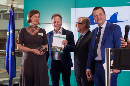 European Commissioner for Environment, Maritime Affairs and Fisheries, Karmenu Vella (centre right), and Jury member Marc Demesmaeker MEP (right) with Sylvia Kalnins and Roberts Rubins (Nature Concerthall Association) – winners of the 2016 Communication Award