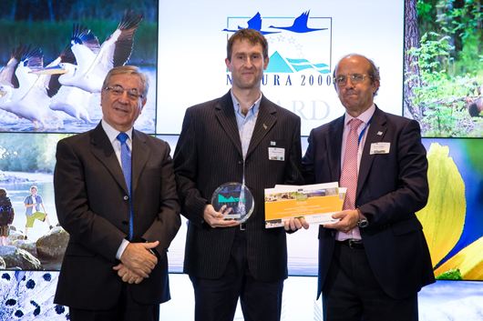 European Commissioner for Environment, Maritime Affairs and Fisheries, Karmenu Vella, with Marton Horvath from BirdLife Hungary, winners of the 2018 Conservation Award, and Daniel Calleja Crespo, Director-General of DG Environment and jury member