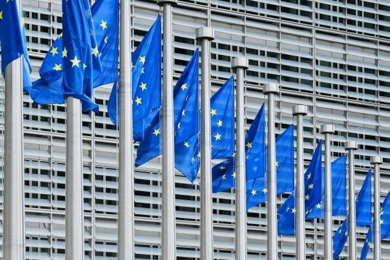 flags flying in front of berlaymont building
