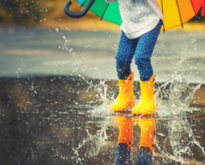 Chidren playing under the rain