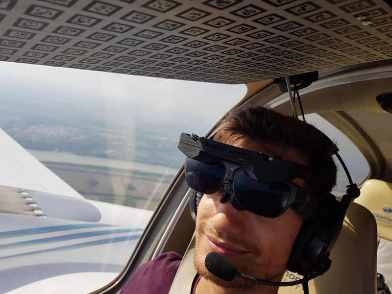 Pilot flying a plane while using the Smart Glasses AERO GLASS
