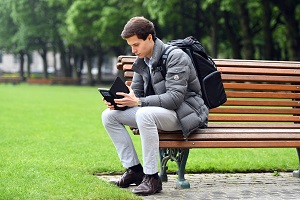 Picture of a man using a mobile phone