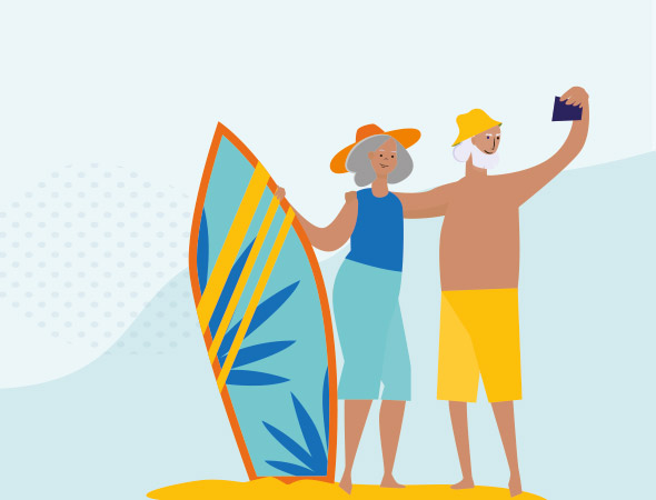 Two older people stand with a surfboard, taking a selfie