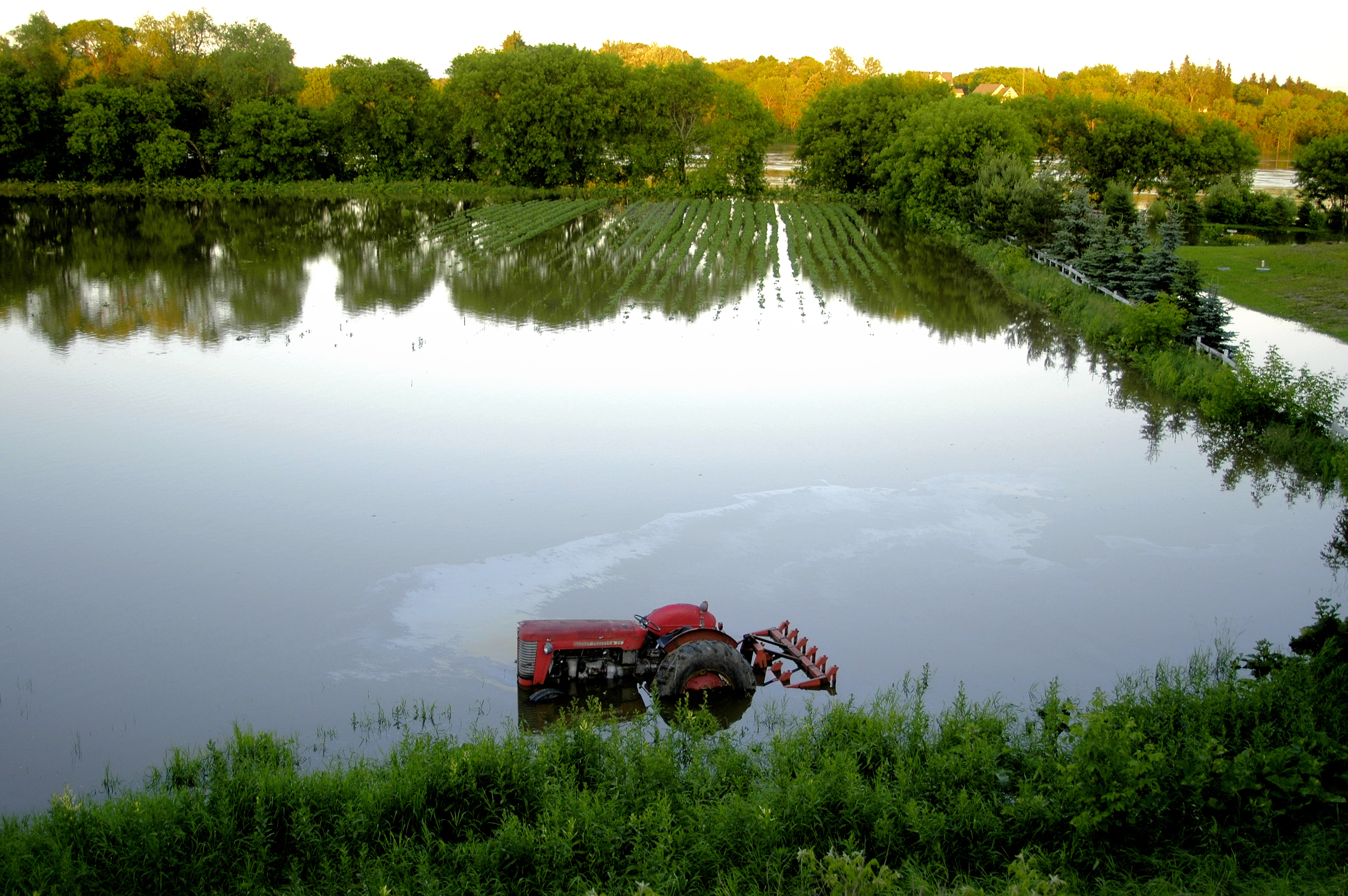 A tractor flooded in the field