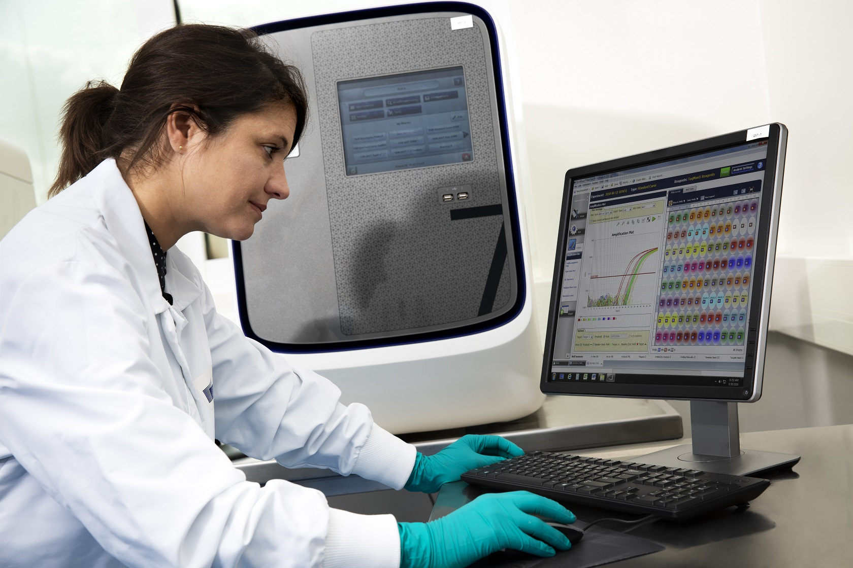 A scientist working at a screen