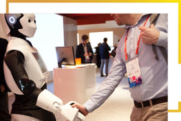 A person shaking a robot's hand