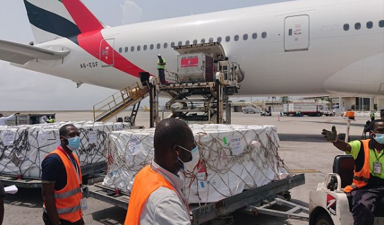 vaccines unloaded from plane, Ivory Coast