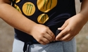 Boy using a wearable sensor for weight loss