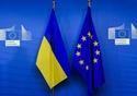 The Ukrainian flag (left), and the European flag © European Union, 2017