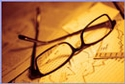 reading glasses on paper © iStockphoto